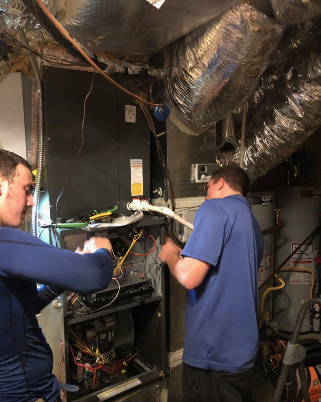 Furnace Being Repaired Two Techs 1